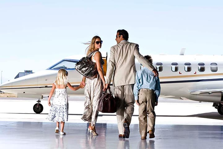 Family getting on a private plane
