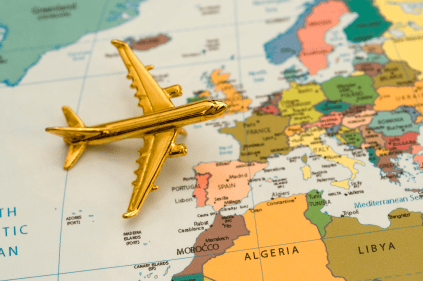 golden toy plane crossing a map